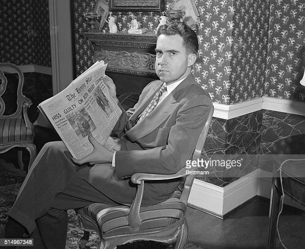 Representative Richard Nixon of California a member of the House UnAmerican Activities Committee is shown scanning the headlines after a Federal...