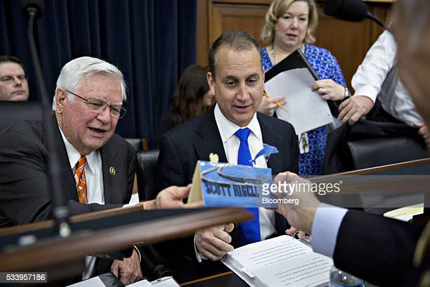 Representative Scott Rigell a Republican from Virginia right shows Representative Harold Hal Rogers a Republican from Kentucky and chairman of the...