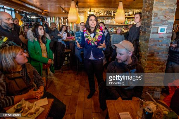Representative Tulsi Gabbard a Democrat from Hawaii and 2020 presidential candidate center speaks to attendees during a campaign stop in Portsmouth...
