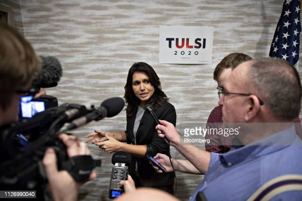 Representative Tulsi Gabbard a Democrat from Hawaii and 2020 presidential candidate center speaks to members of the media during a campaign stop in...