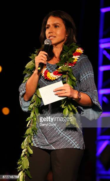 Representative Tulsi Gabbard Democrat of Hawaii speaks before the Sunset on the Beach event celebrating season 8 of 'Hawaii Five0' at Queen's Surf...
