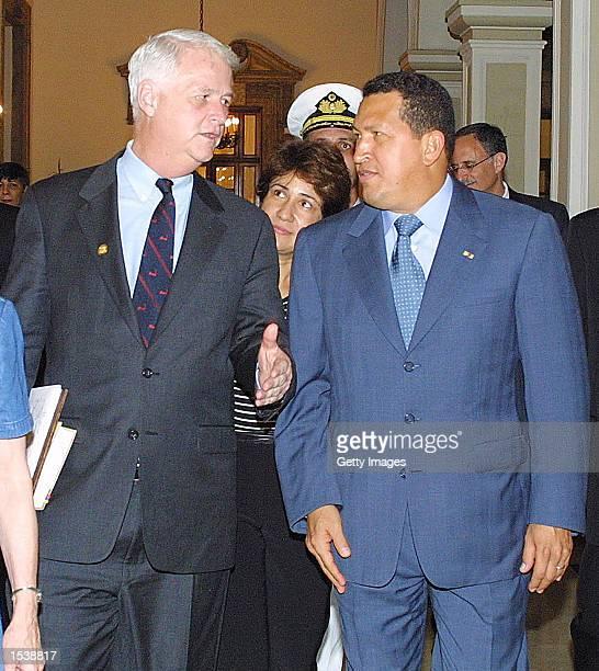 US Representative William Delahunt DMA speaks with Venezuelan President Hugo Chavez as they leave Miraflores presidential palace April 26 2002 in...
