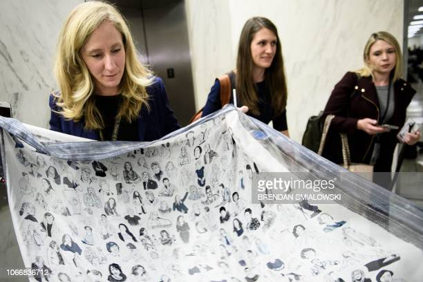 US Representativeelect Abigail Spanberger shows a scarf after an office lottery for new members of Congress on Capitol Hill November 30 2018 in...