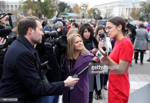 Representativeelect Alexandria OcasioCortez a Democrat from New York speaks with members of the media after a group photo with the 116th Congress...