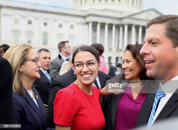 Representativeelect Alexandria OcasioCortez a Democrat from New York smiles after a group photo with the 116th Congress outside the US Capitol in...