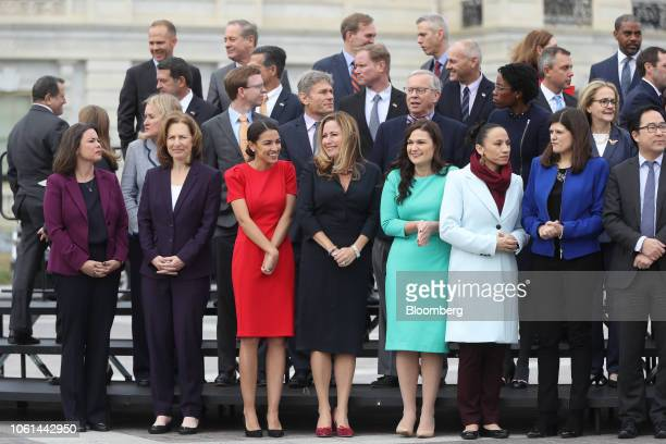 Representativeelect Alexandria OcasioCortez a Democrat from New York third left smiles before a group photo with the 116th Congress outside the US...