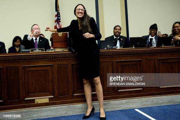 US Representativeelect Alexandria OcasioCortez draws a lottery number for her new office on Capitol Hill November 30 2018 in Washington DC