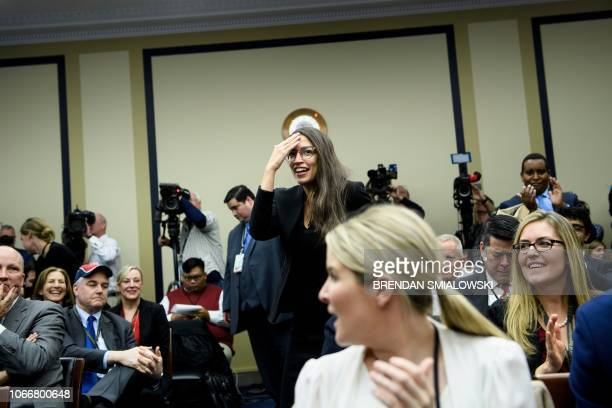 US Representativeelect Alexandria OcasioCortez makes the sign of the cross before drawing a lottery number for her new office on Capitol Hill...