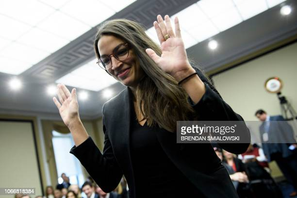 US Representativeelect Alexandria OcasioCortez walks up to participate in drawing a lottery number for her new office on Capitol Hill November 30...