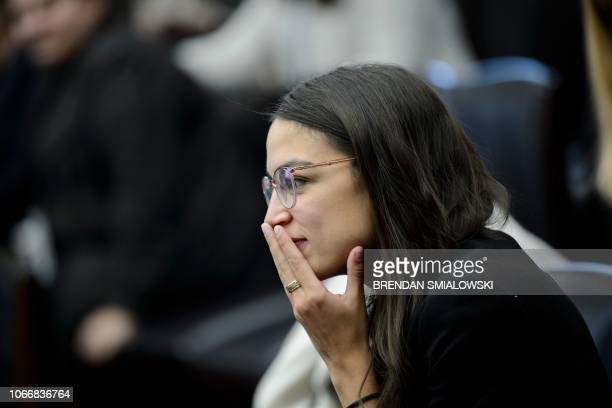 US Representativeelect Alexandria OcasioCortez watches during drawing for new offices on Capitol Hill November 30 2018 in Washington DC