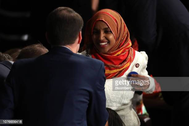 Representativeelect Ilhan Omar a Democrat from Minnesota arrives during a ceremony for the opening of the 116th Congress in the House Chamber in...