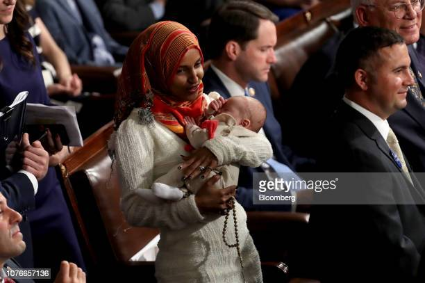 Representativeelect Ilhan Omar a Democrat from Minnesota holds a baby during a ceremony for the opening of the 116th Congress in the House Chamber in...