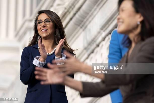 Representative-elect Lauren Boebert, a Republican from Colorado, left, applauds following a group photo outside the U.S. Capitol in Washington, D.C.,...