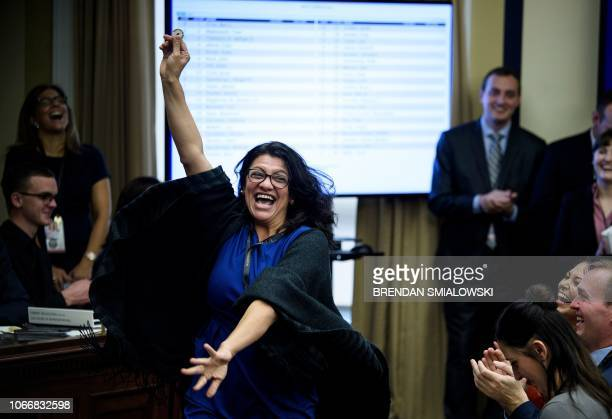 Representative-elect Rashida Tlaib reacts to a good number during an office lottery for new members of Congress on Capitol Hill November 30, 2018 in...