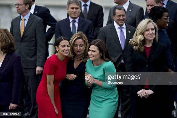 Representativeelects Alexandria OcasioCortez a Democrat from New York left Abby Finkenauer a Democrat from Iowa center right and Abigail Spanberger a...