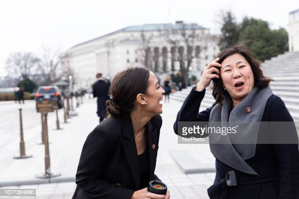 Representatives Alexandria OcasioCortez and Grace Meng talk after taking a group photo with Speaker Nancy Pelosi and fellow House Democratic women in...
