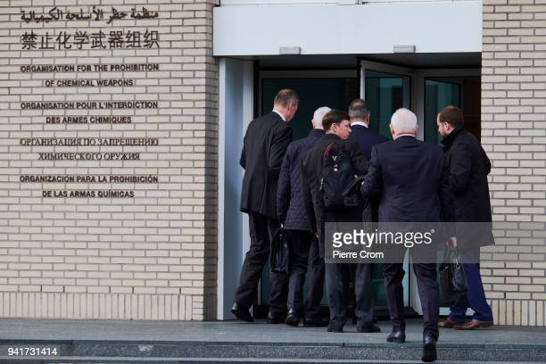 Representatives and employees of the Organisation for the Prohibition of Chemical Weapons arrive at the headquarter building for a special council...