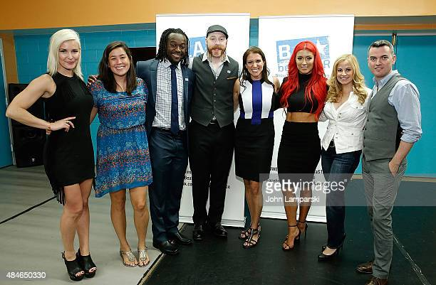 NEW YORK NY AUGUST 20 Representatives and executives supporting the event Renee Young Naomi Hirabayashi Kofi Kingston Sheamus Stephanie McMahon Eva...