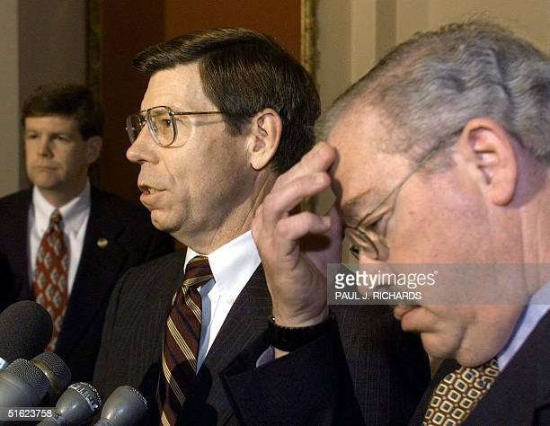 Representatives Bob Barr RGA Bill Mc Cullum RFL talk to reporters in the Capitol 16 January following a session of the impeachment trial of US...