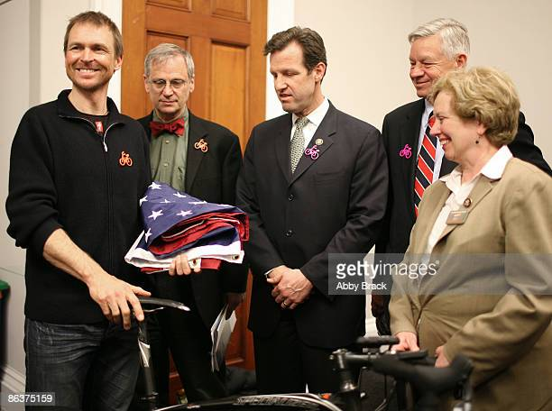 S Representatives Earl Blumenauer Russ Carnahan Tom Petri and Mary Jo Kilroy present a United State Flag to Phil Keoghan after he spoke about his...