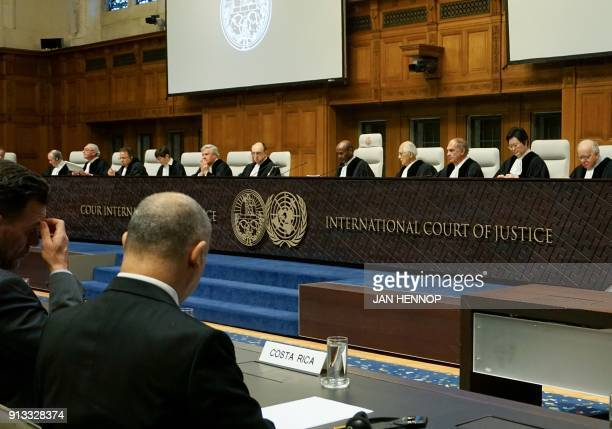 Representatives for Costa Rica listen as judge Abdulqawi Ahmed Yusuf as International Court of Justice judges start reading their verdict in a...