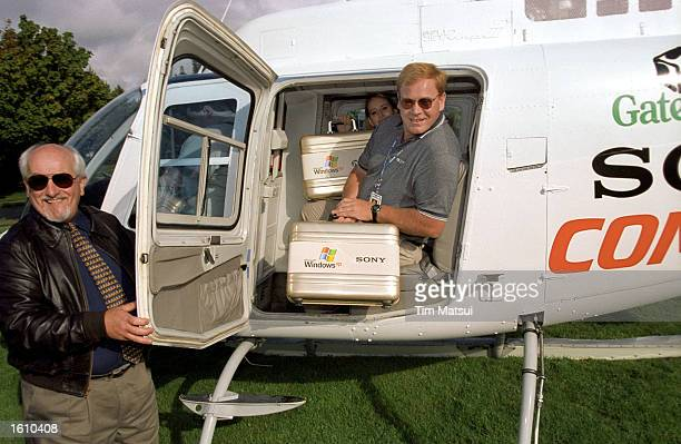 Representatives for Sony and Gateway computers prepare to fly away in a helicopter with CD copies of the new Microsoft Windows XP operating system...