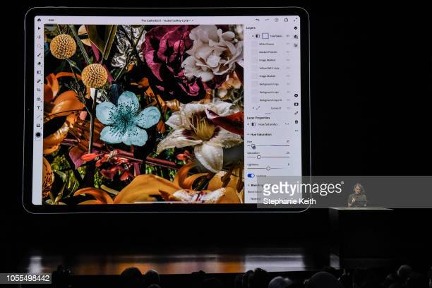 A representatives from Adobe showcases their Photoshop App for the new iPad Pro during an Apple launch event at the Brooklyn Academy of Music on...