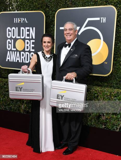 Representatives from EY arrive for the 75th Golden Globe Awards on January 7 in Beverly Hills California / AFP PHOTO / VALERIE MACON
