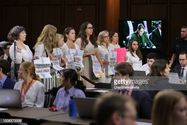 Representatives from faith and proimmigration groups stand and walk out of a Senate Judiciary Committee hearing about the separation of children from...