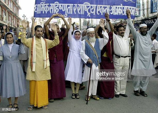Representatives from Nepal's Hindu Buddhist Muslim and Christian communities participate in a march to appeal for religious tolerance and harmony in...