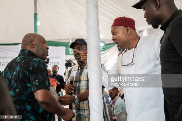 Representatives from parties argue before the aggregating of the total of votes at Rivers State collation centre in Port Harcourt Southern Nigeria on...