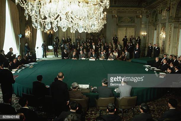 Representatives from the four factions of the Vietnam War meet in Paris to sign a peace agreement. On the left are representatives from South Vietnam...