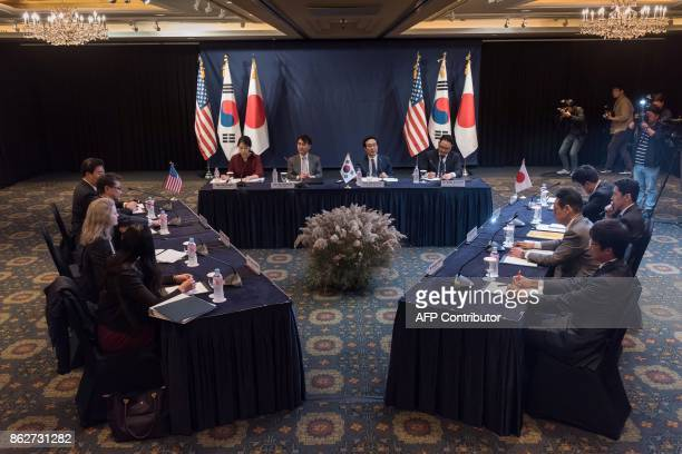TOPSHOT Representatives from the US South Korea and Japan take part in threeway talks on North Korea in Seoul on October 18 2017 / AFP PHOTO / Ed...
