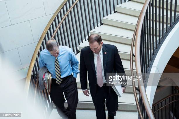 S Representatives Jim Jordan and Lee Zeldin arrive to the Capitol for a closed door deposition with Mark Sandy a senior career official at the Office...