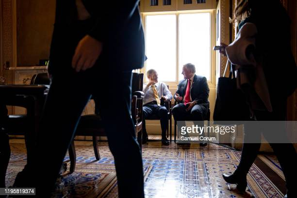 Representatives Jim Jordan and Mark Meadows talk quietly in an alcove in the Senate Reception Room just off the Senate floor during the Senate...
