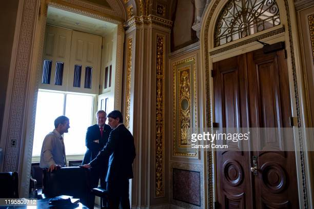 Representatives Jim Jordan and Mark Meadows talk with White House Deputy Press Secretary Hogan Gidley in the Senate Reception Room just off the...