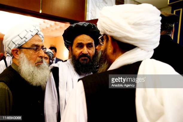 Representatives led by Mullah Abdul Ghani Baradar attend a meeting chaired by Former President of Afghanistan Hamid Karzai, marking a century of...