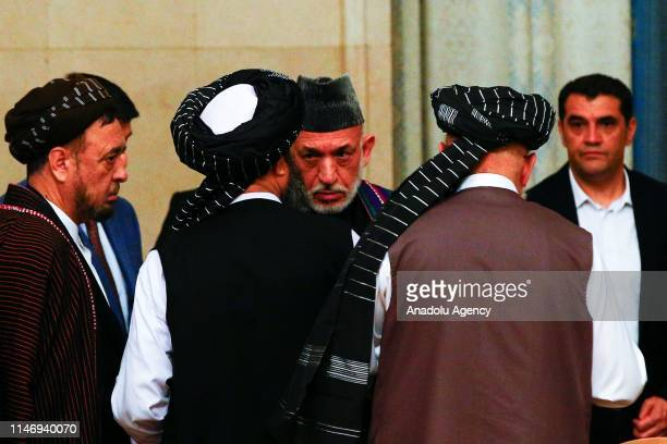 Representatives led by Mullah Abdul Ghani Baradar attend a meeting chaired by Former President of Afghanistan Hamid Karzai , marking a century of...
