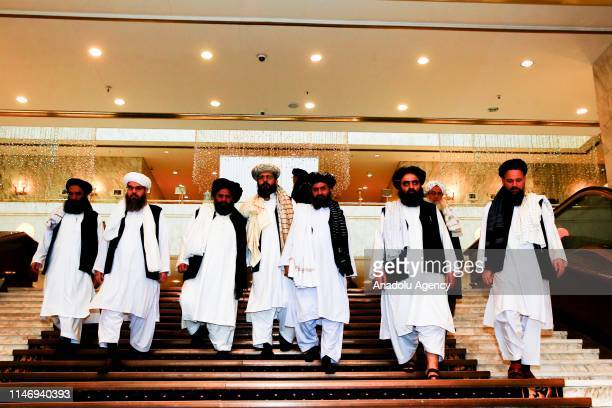 Representatives led by Mullah Abdul Ghani Baradar leave after a meeting chaired by Former President of Afghanistan Hamid Karzai, marking a century of...