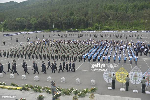 Representatives of armed police soldiers and students attend a memorial service held for Chinese UN peacekeeping soldier Shen Liangliang who was...