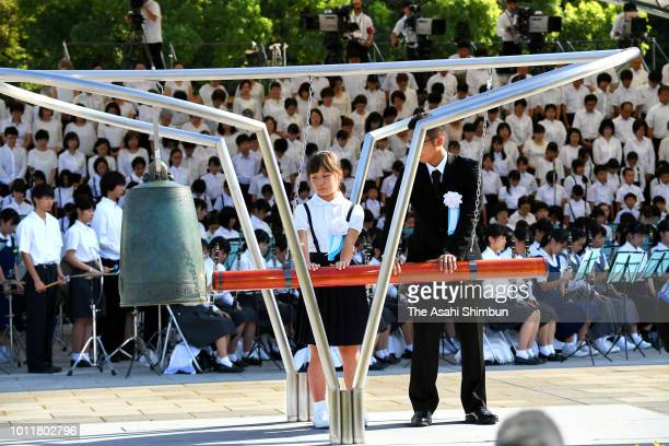 Representatives of bereaved family members hit the Peace Bell during the Peace Memorial Ceremony at Hiroshima Peace Memorial Park on the 73rd...