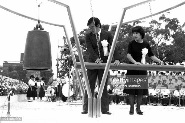Representatives of bereaved family members hits the Peace Bell during the memorial ceremony on the 40th anniversary of the Hiroshima ABomb dropping...