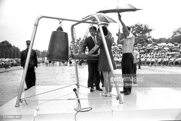 Representatives of bereaved family members ring the Peace Bell during the Peace Memorial Ceremony on the 26th anniversary of the Hiroshima ABomb...