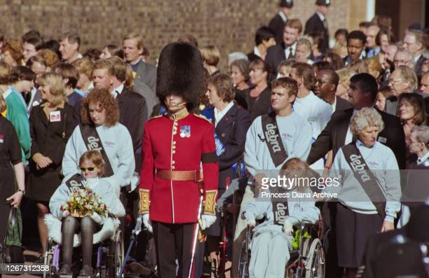 Representatives of charity DEBRA join mourners to remember British Royal Diana, Princess of Wales , outside Buckingham Palace in London, England,...