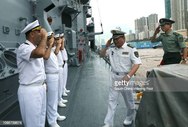 Representatives of Chinese People's Liberation Army Hong Kong Garrison attend the reception aboard Turkish naval frigate TCG Gediz during the warship...