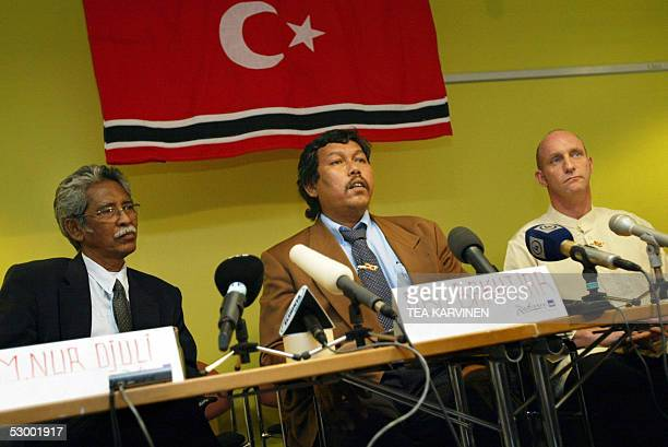 Representatives of Free Aceh Movement Nur Djuli Bakhtiar Abdullah and Doctor Damien Kingsbury speak during a presser 31 May 2005 in Espoo Peace talks...