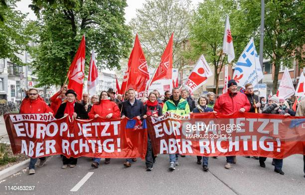 Representatives of Germany's trade unions carry banners reading Europe do it properly now as they attend a Mayday demonstration on Labour Day May 1...