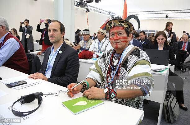 Representatives of indigenous peoples from Brazil and Peru attend the first highlevel session of the Lima Paris Action Agenda on forest at the COP21...