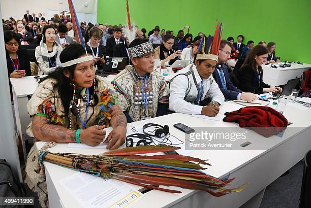 Representatives of indigenous peoples from Brazil and Peru attend the first high-level session of the Lima Paris Action Agenda on forest at the COP21...
