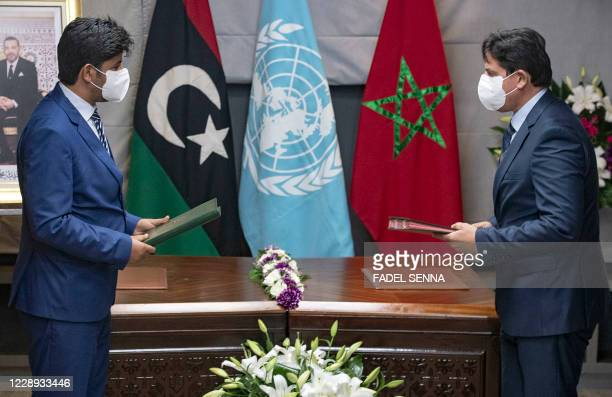 Representatives of Libya's rival administrations take part in a meeting in the coastal Moroccan town of Temara, on October 6, 2020. - Libya's rival...